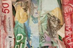 Crinkled Canadian dollar bills closeup. Crumpled Canadian dollar bills close-up, currency crisis concept Stock Photo