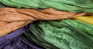 Crinkled crumpled silk fabric textured. Colored crinkled crumpled silk fabric textured Royalty Free Stock Photo