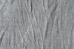 Crinkled gray cloth. Close up of crinkled viscose textile Stock Image