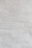 Crinkled paper background. Macro photograph of a crinkled paper background Stock Images