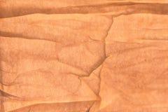Crinkled tan бумажная предпосылка Стоковые Изображения