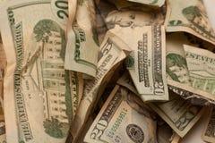 Crinkled us dollar bills closeup. Crumpled american dollar bills isolated on white Stock Image