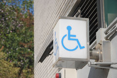 Cripple sign label symbol on wall. Cripple sign label symbol on toilet wall Stock Image