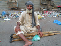 Crippled Beggar. Sitting on street of karachi, Sindh , Pakistan Royalty Free Stock Image