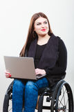 Crippled lady with laptop. Young disabled girl on wheelchair. Health disability internet technology education concept Royalty Free Stock Images