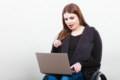 Crippled lady with laptop. Young disabled girl on wheelchair. Health disability internet technology education concept Royalty Free Stock Photo