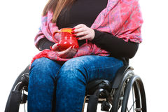 Crippled lady on wheelchair. Disability drink relax leisure concept. Crippled lady on wheelchair. Disabled girl holding red cup drinking beverage Stock Photos