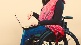 Crippled person with laptop. Young disabled female surfing on web. Internet technology education disability concept Stock Image
