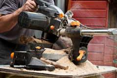 Circular saw cutting wood Royalty Free Stock Photo