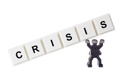 Crisis. Figurines with CRISIS isolated on white background Royalty Free Stock Photo