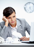 Crisis. Image of young employer looking at laptop with troubled expression Stock Photo