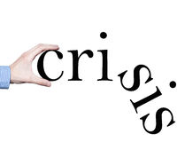 Crisis. A businessman's hand holding the word crisis broken Stock Images