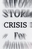 Crisis. Word zoomed in on ebook reader - current events now read by many on electronic devices Royalty Free Stock Photo