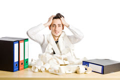 Crisis. Conceptual photo of man sitting at his desk who is in crisis Stock Images