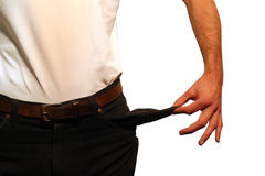 Crisis. A man with empty pockets stock image