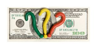 Crisis. One hundred dollar with plasticine questions mark stock photo