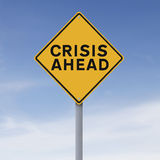 Crisis Ahead. A conceptual warning sign indicating Crisis Ahead royalty free stock photo