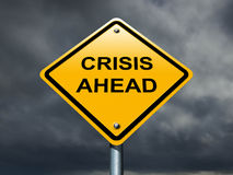 Crisis ahead road sign. Royalty Free Stock Images