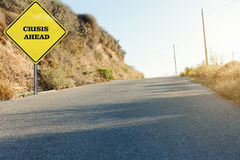 The Crisis ahead road sign on the road side. The yellow Crisis ahead road sign on the road side royalty free stock photo