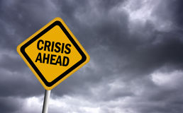 Crisis ahead sign. Over stormy sky Stock Photos