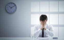 Crisis. Business man frustrated and ashamed with hands on face Royalty Free Stock Photo