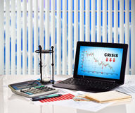Crisis chart on screen notebook Royalty Free Stock Photos