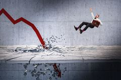 Crisis is coming. Red financial arrow broke the floor and businessman jump away stock photography