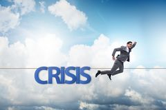 The crisis concept with businessman walking on tight rope. Crisis concept with businessman walking on tight rope royalty free stock photos