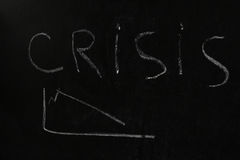 Crisis Concept. Crisis on Dark Background.chalk on a blackboard Royalty Free Stock Photos