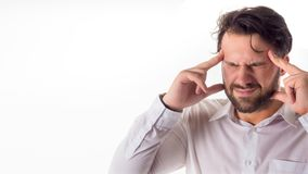Crisis concept: Overburdened businessman closed eyes with both hands at head and shouting isolated on white background. royalty free stock images