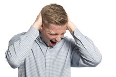 Desperate businessman shouting with hands at head. Royalty Free Stock Image