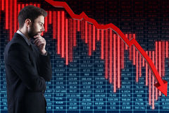Crisis concept. Thoughtful handsome businessman on abstract forex background with decreasing red arrow. Crisis concept. 3D Rendering royalty free stock image