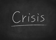 Crisis. Concept word on blackboard background Stock Photo