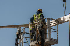 Crisis construction in Spain. men working on a building in Madri Royalty Free Stock Image