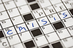 Crisis enigma. Crisis writing in a crossword scheme Stock Photo