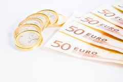 Crisis of eurozone, euro coins on 50-euro banknotes Stock Images