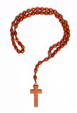 Crisis of faith. Question mark outline made from wooden rosary on white background Royalty Free Stock Photo