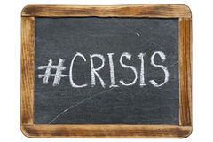 Crisis hashtag fr. Crisis hashtag handwritten on vintage school slate board isolated on white Royalty Free Stock Images