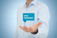 Crisis management. Service concept. Businessman hold virtual label with text Stock Photography