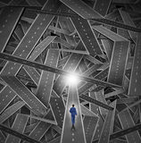Crisis Manager. Business concept as a businessman walking through a maze and direction chaos with a mountain of tangled sharp turn roads as a financial metaphor Royalty Free Stock Image