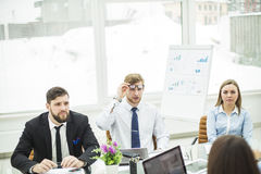 Crisis Manager and business team conducted a working meeting in a modern office Stock Photography
