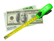Crisis: measuring tape, us dollar and euro Stock Photography