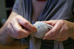 The crisis, mending socks. The crisis, women mending socks Stock Photography