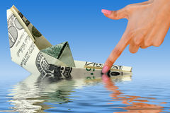 Crisis. money ship in water Royalty Free Stock Image