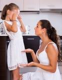 Crisis of motherhood. Sad young women preaching daughter Royalty Free Stock Image