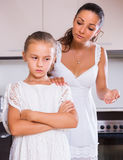 Crisis of motherhood. Sad young women preaching upset little daughter Stock Photography