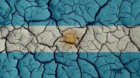 Crisis política o grietas ambientales del fango del concepto con la bandera de la Argentina foto de archivo libre de regalías