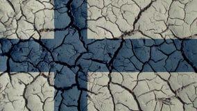 Crisis política o grietas ambientales del fango del concepto con la bandera de Finlandia imagen de archivo libre de regalías