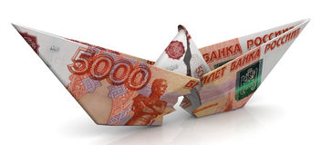 The crisis of the Russian economy. Concept. Torn paper boat made from an Russian banknote ruble on a white surface. Isolated. 3D Illustration Stock Photos