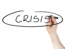 Crisis sign written by a felt tip pen on glass board Stock Images